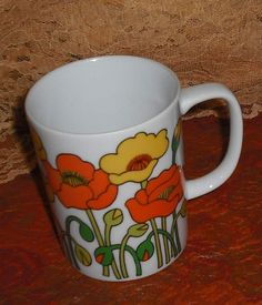 Clearance Vintage FF Fitz and Floyd Cup Mug Retro Mod Groovy Orange Yellow Poppies on White Floral Flowers Flower Power Home Kitchen Dining by SuVasi on Etsy https://www.etsy.com/listing/105251503/clearance-vintage-ff-fitz-and-floyd-cup