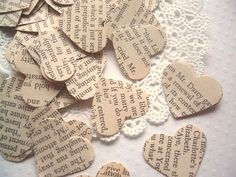 Use a book about classic love stories to punch heart shapes from- Valentines day or Wedding shower