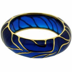 Resin midnight bangle with intricate 24K gold-plated framework.