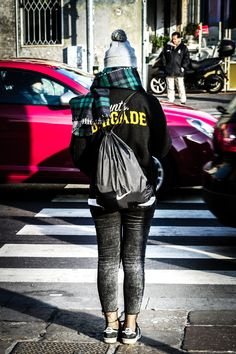 A Girl crossing a high traffic road during a winter sunny day high contrast and blurred background - A Girl crossing a high traffic road during a winter sunny day high contrast and blurred background