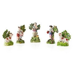 GROUP OF STAFFORDSHIRE WALTON AND WALTON TYPE FIGURES EARLY 19TH CENTURY comprising a gardener and companion, 13cm high; a boy with a basket of flowers emblematic of Spring, marked WALTON, 15cm; and a pair of pearlware recumbent sheep, 11cm high (5)