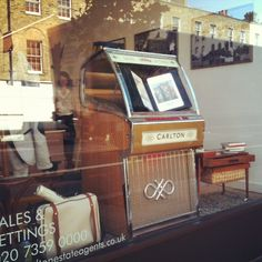 The window at Carlton Estate Agents; our first window display. Original and refined