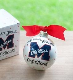 Any fan will love this Ole Miss We Wish You Ornament. Personalize it with a name and date for a special holiday keepsake. All collegiate ornaments come boxed and tied with a coordinating ribbon making them the perfect gift for anyone.