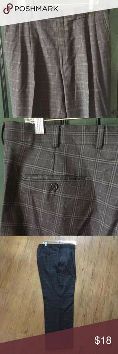 Burberry Pleated Plaid Pants Pleated fronts, and cuffed hems. Front pant leg is lined to the knee. In excellent used condition. Burberry Pants Dress