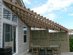 Triangle pergola with privacy screen.
