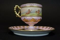 A VERY FINE DRESDEN CUP AND SAUCER