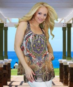 Embellished Tunic Top- Beautifully sexy swing-shaped  tunic. Lavishly rhinestone embellished embroidered tunic with lace racer back. This amazing top goes with everything and is just the right length to wear with our comfy European pant. http://www.blondibeachwear.com/Embellished_Tunic_Top_p/toppeacocktunic.htm