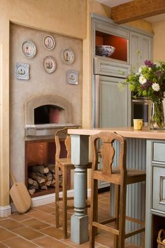 This goes with a previously pinned kitchen, love the pizza oven!
