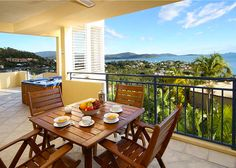 Outdoor Living Areas with Aluminum Shutters = Breakfast for four.