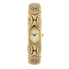 LOT:37 | BULGARI - a lady's factory diamond set yellow metal Alveare bracelet watch.