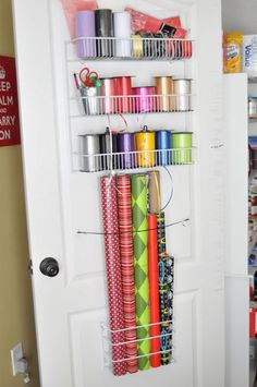 Gift Wrap Organization: Even if you're working with a strict budget, you can still create a functional organization system for everything. This storage solution was done with inexpensive items found at a discount superstore. Find out here how it was done.