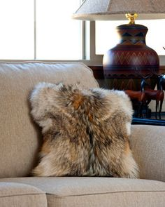 b19a15239673 Wester coyote fur pillow displayed on sofa from True North Furs Cowhide  Pillows