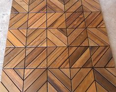 The Dubai pattern of Itauba Brazilian Hardwood deck tiles allows for some very unique installations. Wood Floor Pattern, Floor Patterns, Tile Patterns, Floor Design, Ceiling Design, Wall Design, Wood Parquet, Timber Flooring, Wood Tiles