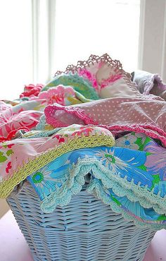 umla, crochet-trimmed pillowcases in a basket… by rose...