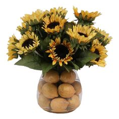 Create a lush tablescape or charming vignette with this lovely faux sunflower arrangement, nestled in a glass vase filled with lemon accents.
