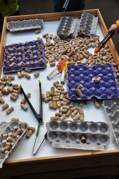 Fine motor skills with corks and egg boxes.  Gloucestershire Resource Centre http://www.grcltd.org/scrapstore/