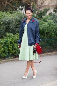 Such a cute photo of Tina! in a cute pastel mint dress too! #streetstyle #chic #pfw