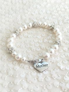 Mother Pearl and rhinestone bracelet mother by AliChristineBridal  #motherofthebride #motherofthegroom #mothergifts