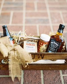 This basket of groomsmen goodies included a monogrammed steak brander (which was also used to brand the side of each crate), a bottle of Jack Daniel's, a bottle of local beer, spice rub, and some grooming items