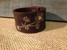 Leather cuff bracelet, handmade from recycled men's belt, silver flower embellishment