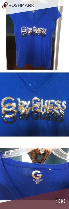 "SPARKLY SEQUIN GUESS V NECK TOP SIZE- XL LIVELY, FLIRTY & ROYAL BLUE with Slight Plunging V Neck Top By GUESS, Adorned with Lines Of Silver, Gold & Black Sequins. SIZE- XL 100% Cotton, Chest Measurement- 19"". Worn Once, Laundered- Hang Dried & has been stored in drawers. EXCELLENT CONDITION!! GUESS Tops"