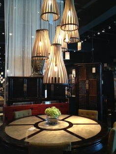 The ever so cool Four Hands showroom had a lot of great things going on (& not just because they throw the best party in town during High Point Market!) – loved these cluster of pendants and the round dining table. #HPmkt via @materialgirls