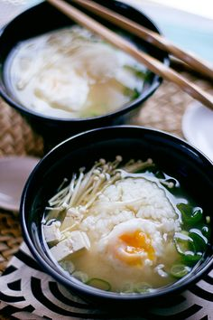 Japanese miso soup with egg, rice, tofu, and enoki mushrooms