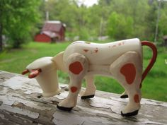 I remember this toy cow. I have it in my kid's Fisher Price Play Farm I've kept for my grand kids to play with.