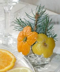 christmas decorations and table centerpieces with lemons