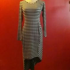 Yipes stripes! SUPER cute asymmetrical hi/lo dress! Preloved in good shape....only flaw is seam appears to be separating slightly as shown in pic 3/4. Not noticeable when wearing. Have only worn this dress 1 time. Non-smoking home. Save 20% by bundling two or more items. Gift with every purchase! (78% polyester, 17% rayon, 5%spandex, made in USA) Bar III Dresses