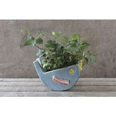 Escape the ordinary planter with our stoneware bird planter.  Fill this cute fellow (or lady, if you prefer) with flower bundles or a simple green leafy plant to let the colorful stoneware stand out. #paulmichaelcompany #birdplanter #bird #putabirdonit #greenthumb