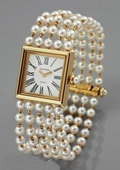 Chanel pearl bracelet watch.