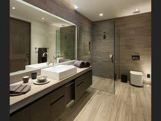 Modern 3/4 Bathroom with High ceiling, European Cabinets, Hardwood floors, Vessel Sink, Wood counters, Skylight, Flush