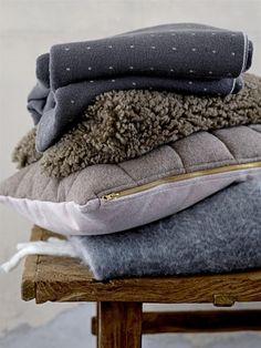 Shopinstijl.nl - Warme grijze, bruine en blauwe kussens en plaids - bekijk en koop de producten van dit beeld op shopinstijl.nl