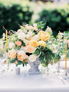 chic yellow centerpiece - http://ruffledblog.com/old-world-southern-charm-elopement-inspiration #flowers #centerpieces