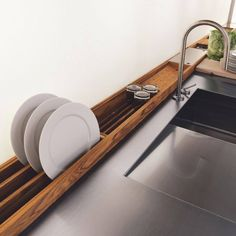 Mounted drying racks on wall behind sink