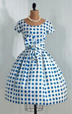 Retro 50's/60's White with Blue polka dots.  Gorgeous!  I absolutely LOVE this dress--only need to lose about 60 pounds to be able to wear it.  Incentive, right? :))