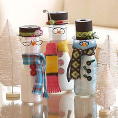 Repurpose old jars to make cute snowmen. Fill a clean jelly jar with Epsom salt. Fit a smaller jar (a such as baby food jar) to the top of the jelly jar, hot-gluing in place. Paint the outsides with glitter glue; let dry. Make a hat from one end of a ribbon spool by painting it black. Accessorize the snowman with buttons, wire glasses, a fleece scarf, and bright ribbon.