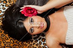 top view of a woman with a rose in her hair. - Top view of a beautiful Indian female fashion model  with a rose in her hair, Model: Stephanie Reddy