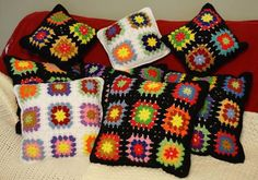 Repurposed an old, heirloom Granny Square Afghan into a set of many colorful pillows!