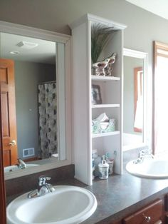 Contractor mirror AFTER: Customized into storage shelves & framed out mirrors above each sink!