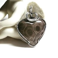 A genuine Petoskey stone from the shores of Lake Mi., that I cut, shaped and polished and then wire wrapped in Sterling Silver. Wire Wrapped Jewelry, Wire Jewelry, Petoskey Stone, Stone Pendants, Wire Wrapping, Wraps, Jewelry Making, Jewels, Sterling Silver
