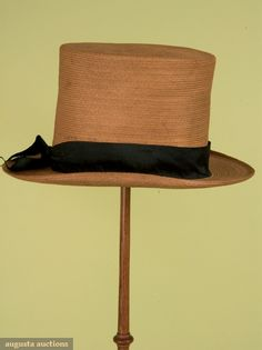 GENTS STRAW TOP HAT, 1825-1850 November, 2007 -Tasha Tudor Historic Costume Collection New Hope, PA Fine braided straw, black silk ribbon band, leather or gut sweat band, paper crown lining, cylindrical crown, narrow 2.25 brim with slightly upturned sides, excellent.