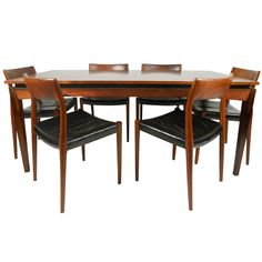 Rosewood Table and Six J L Moller Chairs   From a unique collection of antique and modern dining room sets at https://www.1stdibs.com/furniture/tables/dining-room-sets/