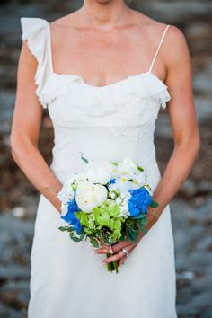 Bright pops of blue. Photography by emilieinc.com, Floral Design by fiddleheadflorist.com