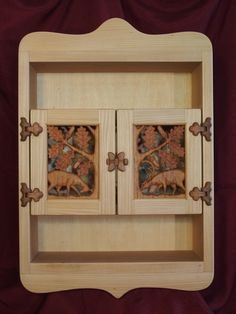 Carved wooden cupboard, made from linden (the frame), alder (the openwork carving) and apple (hinge & locking) wood.