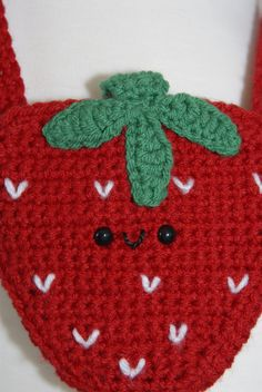 """These Yummy Strawberry Crochet Hip Purse are from my new collection Gitana's Yummies they are crocheted by me and they are exclusive design by """"Gitana's Flip Flops"""". These beautiful and unique crochet purse are handmade with 100% soft acrylic yarn, lining inside and embellished with a strawberry polymer clay button handmade by me and the best part of it is they are non preservative, non calories and is fat free. :) Measures: 5 1/2""""H x 5 1/2""""W Straps: 43"""" Wash by hands and dry flat."""