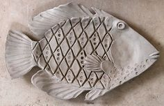 Pottery and Paint: Turretfish (in progress) and a Triggerfish plate