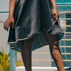 """""""Luxury is in the detail"""" Our flared, high-low dress contains an intricate, teardrop cut at the bust, followed by a dash of bold African print. The low back &high front gives this modern black dress a true African contemporary finish. #strutcyan The Struts, Contemporary, Modern, High Low, It Is Finished, African, Detail, Luxury, Shopping"""