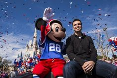 Mickey rides in a celebratory parade with Baltimore Ravens quarterback Joe Flacco.
